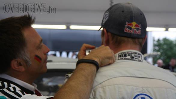 Volkswagen Motorsport boss Jost Capito giving Jari-Matti Latvala's face the German flag treatment