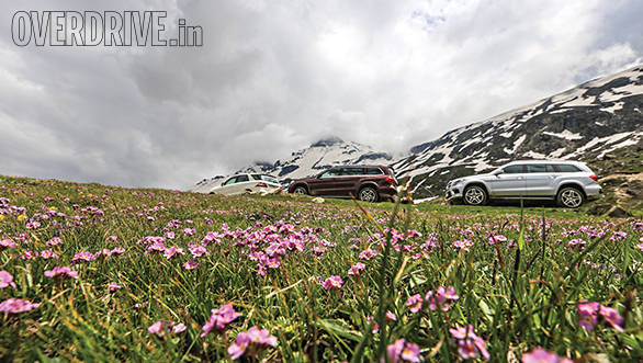 At the touch of a button the ground clearance was raised to its maximum and the big SUVs confidently soldiered on