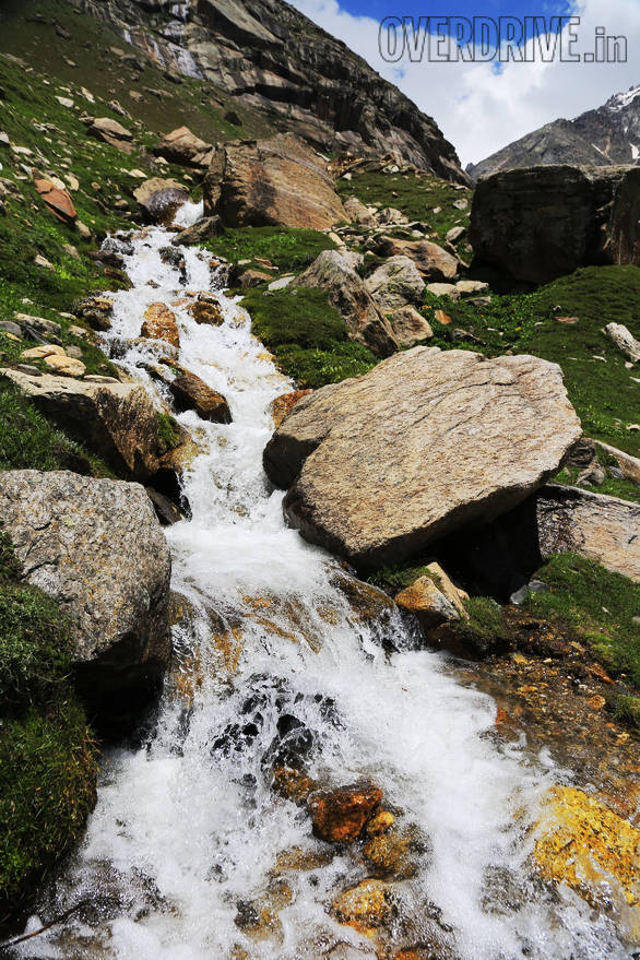 Fast moving streams of frigid waters pour down the mountains as the glaciers melt in the heat of summer