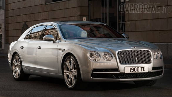 Bentley Flying Supr V8 has subtle styling differences from its W12 sibling - like the black lower grille instead of chrome and a red background for the Bentley winged logo.