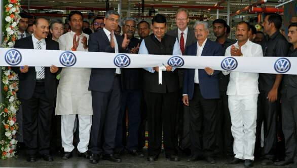 Maharashtra CM Devendra Fadnavis alongside VW India officials inaugurating the new engine assembly plant