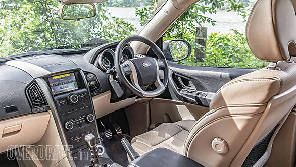 XUV500 gets updated interior that features a new dual-tone dashboard and soothing blue lighting. Quality has improved but still not on par with rivals. Twin-pod dials look funky