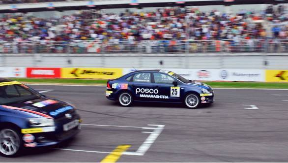 Anindith Reddy crosses the finish line just ahead of the rest of the pack in Race 3 of the Round 3 of the Vento Cup at the BIC