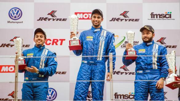 Anindith Reddy on the top step of the podium, with Ishaan Dodhiwala to the left in second place, and Karminder Pal Singh to the right in third place