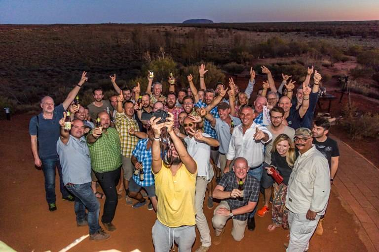 Farewell party on a sand dune overlooking the amazing Ayers Rock