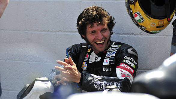 PACEMAKER BELFAST 04/06/11: TAS Relentless rider Guy Martin laughs with his crew before the opening Superbike race of the 2011 Isle of Man TT