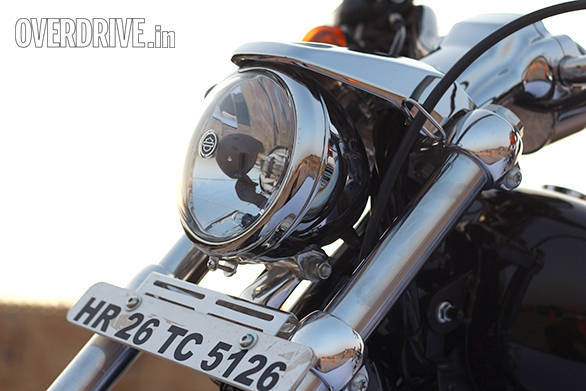The small Harley-Davidson 1200 Custom head lamp looks good and projects a powerful beam. Not sure about the stylistic merit of the eyebrow that sits on top.