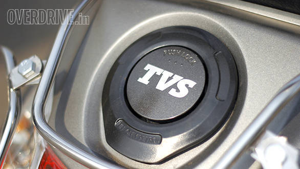 Both scooters have external fuel filler caps but the Hero's is covered and can be accessed via the ignition key slot while the TVS lid opens via the boot key slot