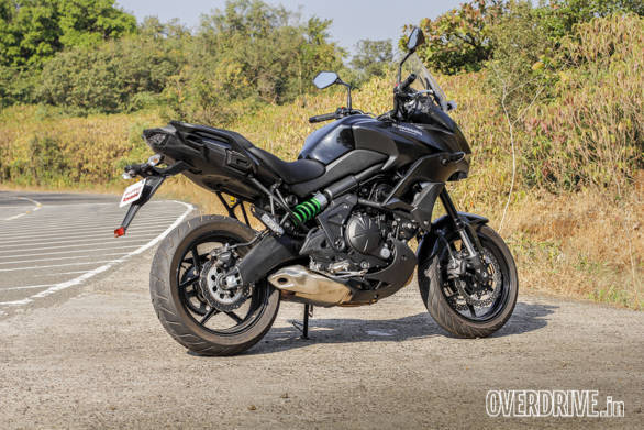 The Kawasaki Versys 650 uses a trellis frame that ends with a plastic cover over the swingarm pivot. Also note the grabrail ss which neatly integrated mounting points for Kawasaki's optional hard luggage