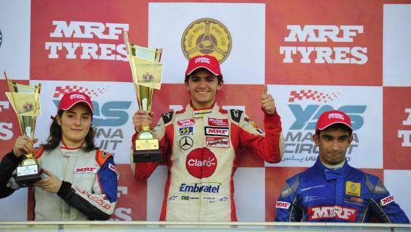 Fittipaldi, flanked by title rival Tatiana Calderon and Indian driver Tarun Reddy