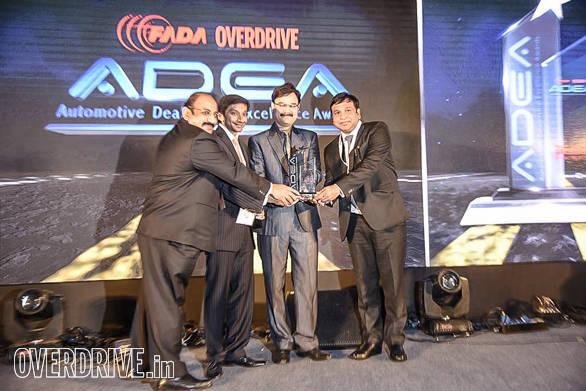 (L-R): John Paul, Vice President, FADA; Narain Karthikeyan, Formula One motor racing driver; Pankaj Dubey, Managing Director, Polaris India giving the dealer of the year for two-wheeler luxury category to Gallops Motors, KTM