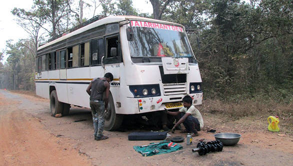 Engine being rebuilt on the road. Can only happen in India