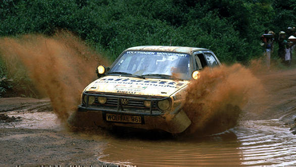 Eriksson and co-driver Peter Diekmann at the Ivory Coast Rally in September 1987, splashing through the stage in their Volkswagen Golf GTI