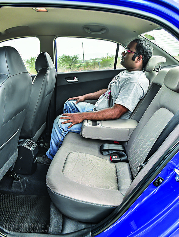 Rear seat comfortable for long-distance journeys. Rear AC vents and centre armrest with cupholders are handy inclusions