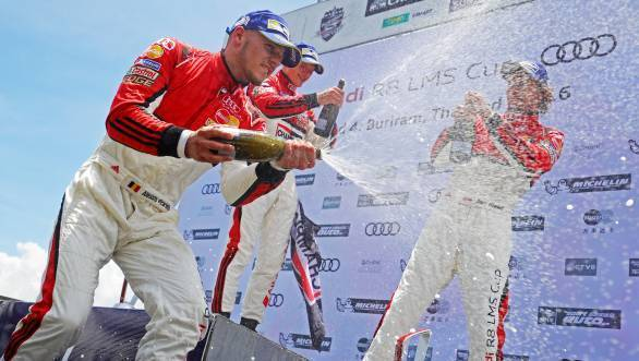 Martin Rump, Alessio Picariello and Jan Kisiel celebrating on the podium of Race 2 of Round 2 of the Audi R8 LMS Cup at the Chang International Circuit