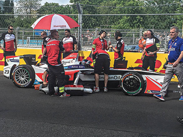On the grid before the race, the Mahindra crew makes sure everything is ready for Heidfeld