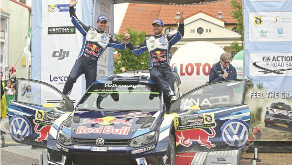 Mikkelsen and co-driver Andreas Jaeger celebrate their win at Rally Poland