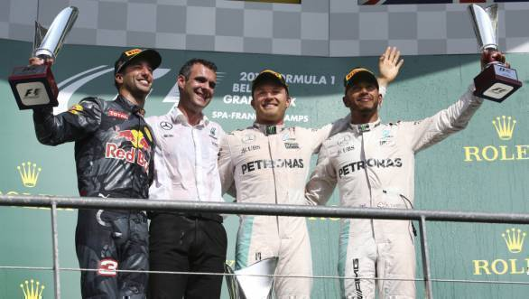 Second placed Daniel Ricciardo, race winner Nico Rosberg and Lewis Hamilton who finished third, atop the podium at the 2016 Belgian Grand Prix