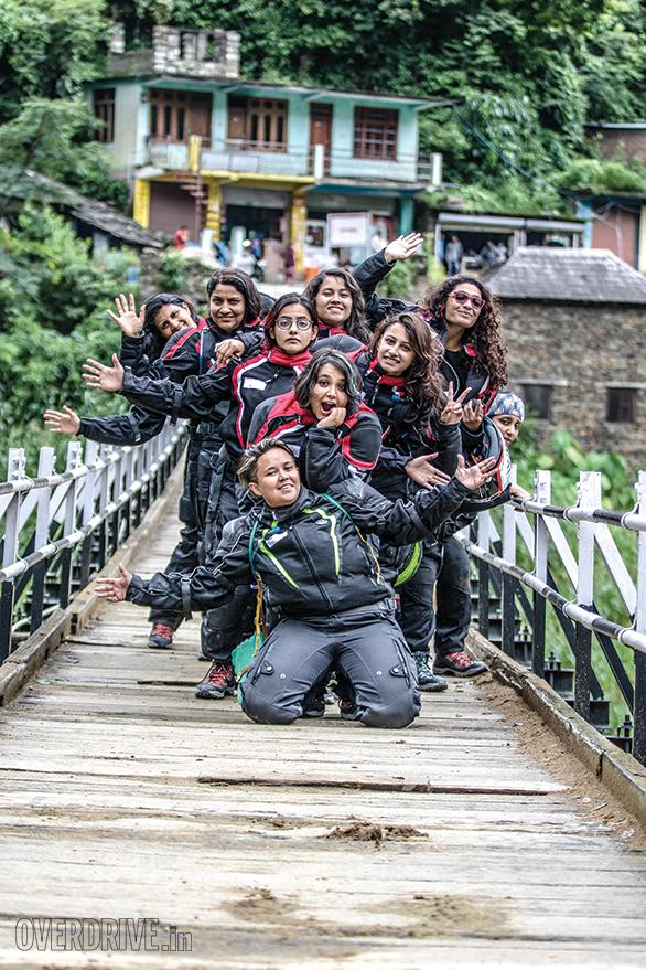 The ladies of the TVS Himalayan Highs Season 2 post on a suspension bridge near Aut between Mandi and Manali, in Himachal Pradesh