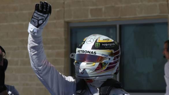 Lewis Hamilton celebrates his pole position at the 2016 US GP