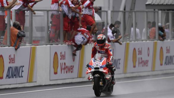 Andrea Dovizioso took a fine win at a very wet Sepang