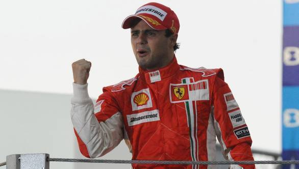 Felipe Massa celebrates his win at the 2008 Brazilian GP, while also bravely trying to hold back tears after losing the title by one point