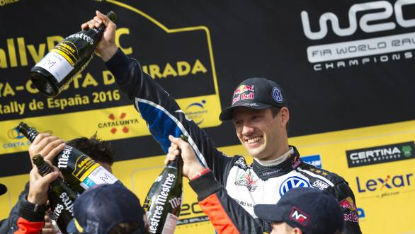 Sebastien Ogier celebrates his victory at Rally Catalunya, which helped him seal his fourth consecutive World Rally Championship title