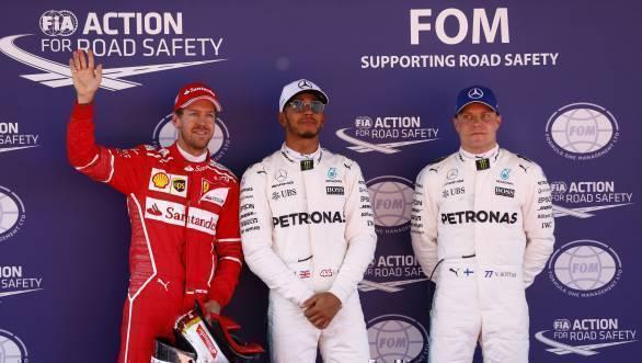 Hamilton flanked by Sebastian Vettel and Valtteri Bottas