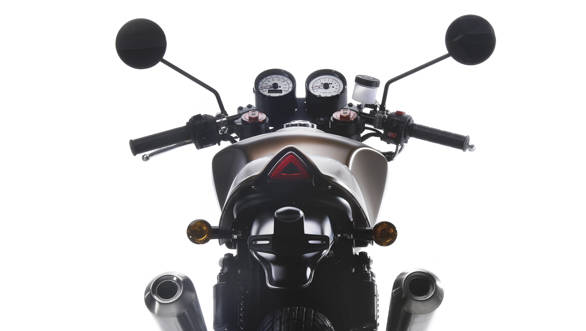 The SWM Gran Milano rear cowl is well made and we saw painted as well a leather-finished example. The little triangular light inset into the cowl is a good little detail