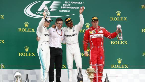 The Mercedes trio certainly are jubilant, while Kimi Raikkonen looks appropriately sullen after having to settle for third place