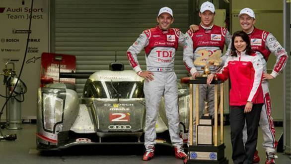 Ace race engineer Leena Gade and drivers Benoit Treluyer, Andre Lotterer and Marcel Fassler with their trophy after winning the 24 Hours of Le Mans