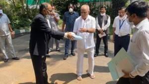 TVS Motor Company hands over 3,000 PPE and 10,000 N95 masks to Karnataka CM