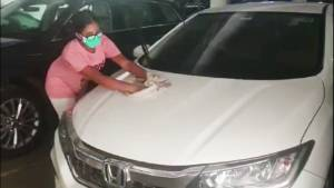 School students from top schools clean cars to Steer-a-Change